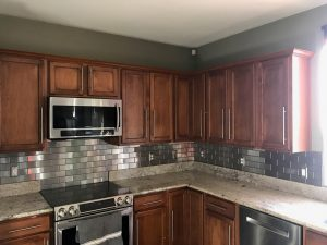 Stainless Steel Subway Tile backsplash in a Kitchen remodel